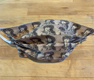 Photo of a facemask with a repeating image of Annie Oakley